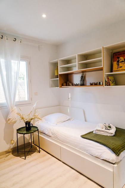 Une chambre avec un lit gigogne bien commode