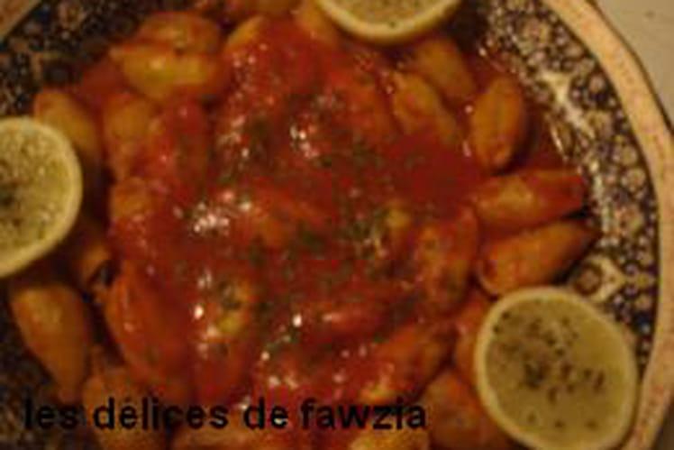 Encornets farcis à la viande et sauce aux épices