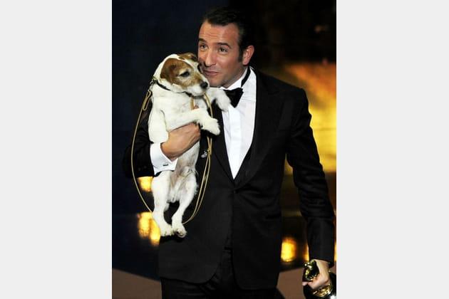 Jean Dujardin et Uggie aux Oscars