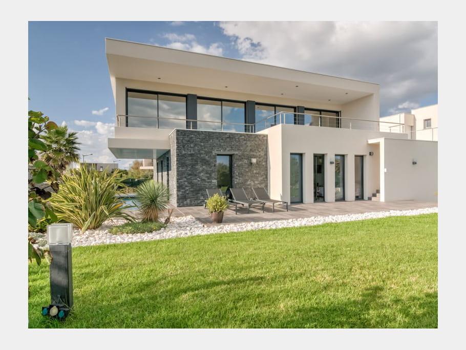 Maison avec pierre de parement 10 super maisons d - Maison en pierre giordano hadamik architects ...
