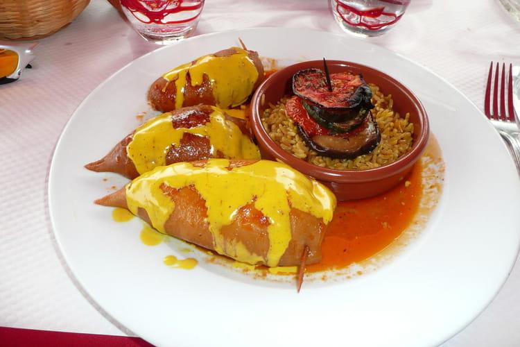 Encornets farcis au porc à la sauce tomate