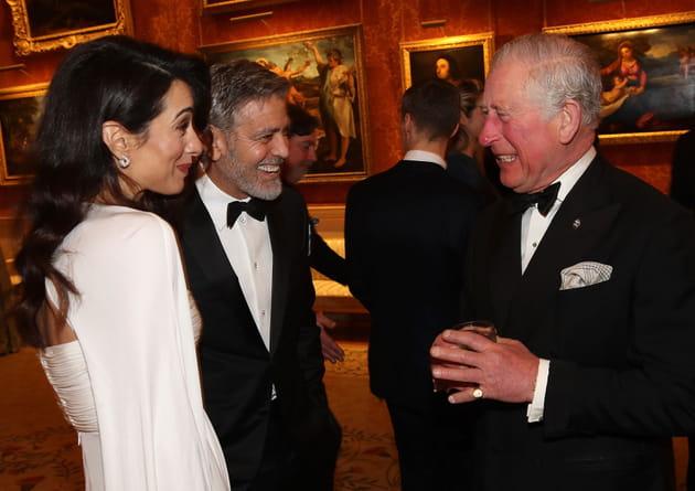 Amal et George Clooney et le Prince Charles, hilares à un dîner de bienfaisance au Palais de Buckingham