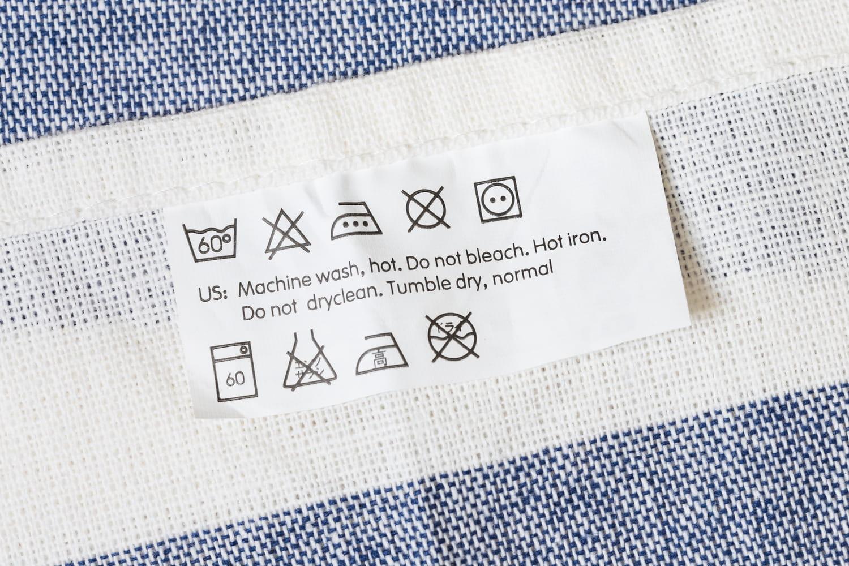 Les symboles d'entretien du linge de maison: ce qu'ils signifient