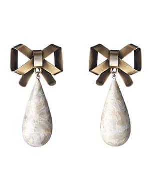 boucles d'oreilles à noeuds dorés de dior