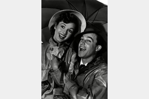 """Avec Gene Kelly, son partenaire dans """"Chantons sous la pluie"""""""