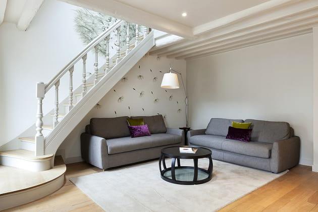 coin salon sous l 39 escalier. Black Bedroom Furniture Sets. Home Design Ideas