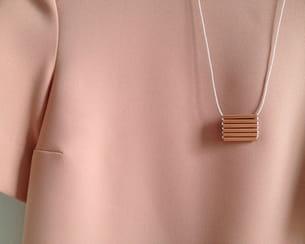 collier en tubes de cuivre