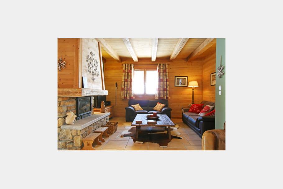coin cosy pr s de la chemin e couleurs et luxe au chalet journal des femmes. Black Bedroom Furniture Sets. Home Design Ideas