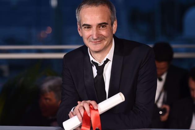 Olivier Assayas partage son Prix de la mise en scène avec Cristian Mungiu