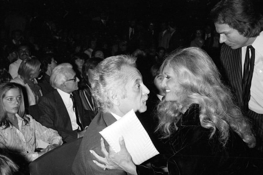 Georges Brassens et Dalida assistent à un spectacle à Paris, 1980