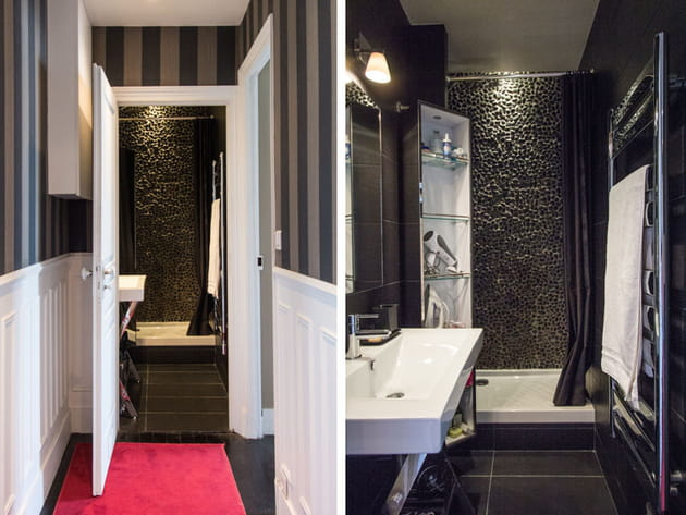 salle de bains avec galets noirs
