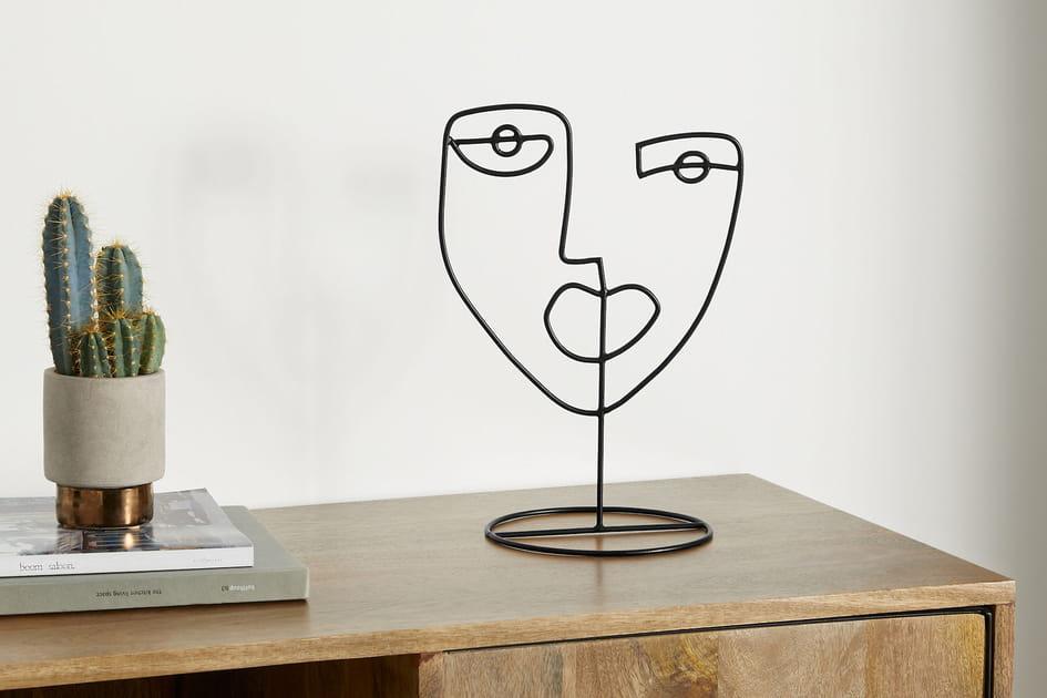 Sculpture visage Made