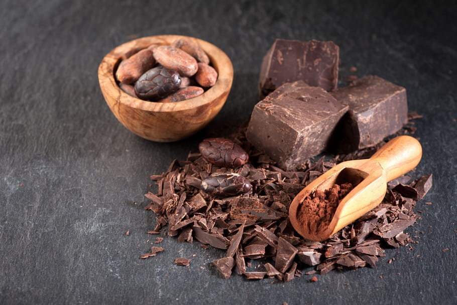 Image result for dark chocolate on wooden table