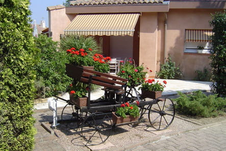 La carriole à géraniums