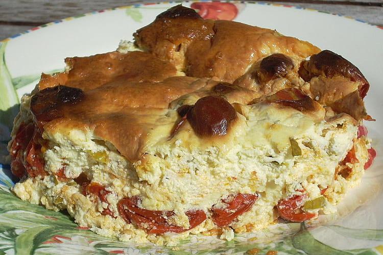 Clafoutis aux tomates cerises, crème fraîche et basilic